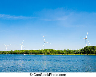 Lake Brielse Meer with wind turbines, Netherlands - Row of...