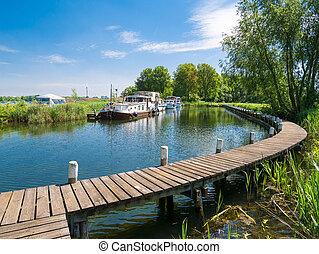 Boats at moorings at Lake Brielse Meer, Netherlands -...