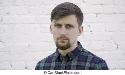Serious man with a beard