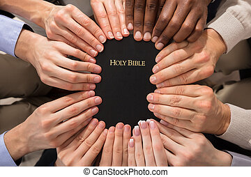 Hands Holding Holy Bible - Overhead View Of Hands Holding...