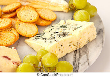 Cheeseboard - Close up of a variety of cheese and garnishes...