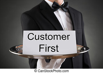 Waiter Holding Customer First Card On Tray