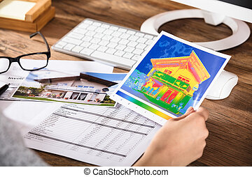 Person Analyzing The Thermal Image Of A House