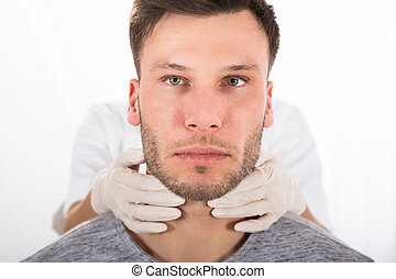 Man Getting Thyroid Gland Control