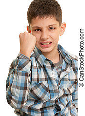 Aggressive kid - An angry boy is demonstrating his fist;...