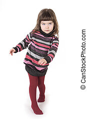 little girl in red tights and a bright dress on a white background