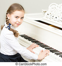 A girl from a music school plays the piano. - Charming...