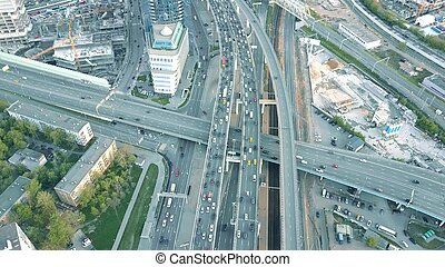 Aerial shot of heavy traffic jam on the highway flyover -...