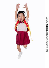 Asian Little Chinese girl in school uniform with school bag...