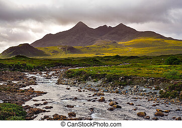 Dramatic landscape of Cuillin hills and river, Scottish...