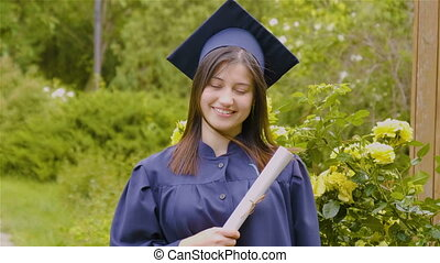 Graduated young woman smiling at camera - Smiling young...