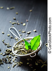 Delicious green tea in old metal strainer