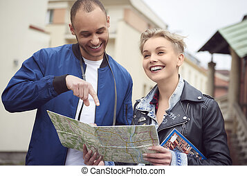 Waist up of couple with tourist equipment
