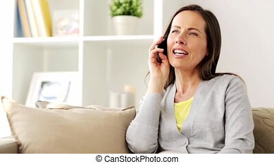 happy woman calling on smartphone at home