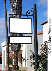 Two blank signs with a copy space area