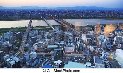 Osaka skyline sunset - High-rise buildings in the middle of...