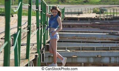 Girl and bridge. Beautiful sexy lifestyle girl is standing...