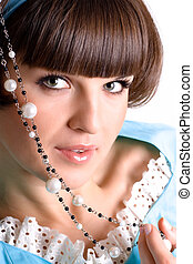 brunet woman with pearl beads - closeup portrait of...