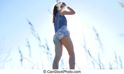 Sexy girl in shorts. Ass Girl Outdoors nature lifestyle -...