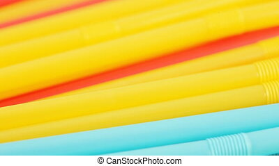 A cocktail colored stick - Plastic colored cocktail beverage...