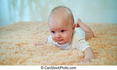 Baby Lying on Stomach on a Cozy carpet