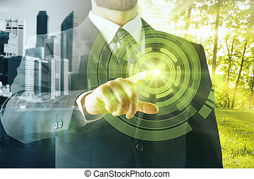 Green business concept - Businessperson pointing at abstract...