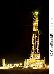 Oil derrick at night on Oklahoma plains