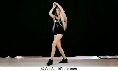 Young blond woman 20-25 with long flowing hair ends dance on...