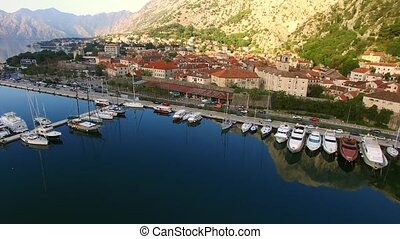 Boat dock and mooring for ships and yachts in Kotor. Bay of Koto
