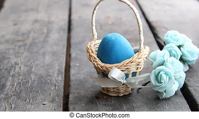 Easter egg Easter egg in basket on rustic table - Blue...