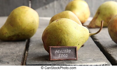healthy food - tag with an inscription and pears on old...