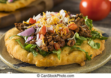 Homemade Indian Fry Bread Tacos with Ground Beef Lettuce and...