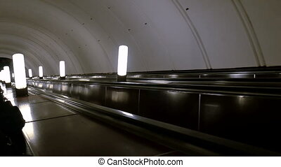Escalator in the subway moving down. Moscow metro station...