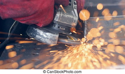 Grinding machine tool in use. Slow motion. - Worker using...