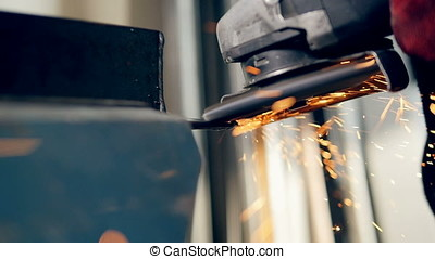 Grinder being used to process metal. Slow motion. - Someone...