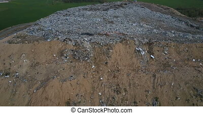 Aerial view of the pile of trash. Copter flying away from...
