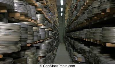 Thousands of film reels being stored in film archive. - A...
