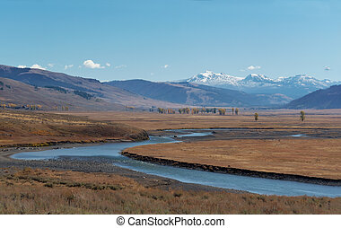 Yellowstone National Park: Gardner River with snowcapped...
