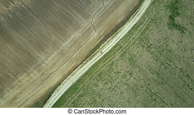 Aerial top view. Drone turning over the field. Beautiful...