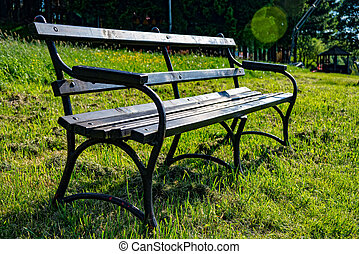 Park bench on the edge of a way - A Park bench on the edge...