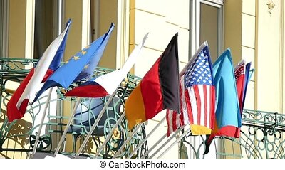 State flags of some countries moving in slow motion over some building in Prague