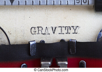 Gravity typed on an old paper using vintage typewriter.