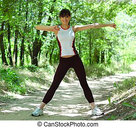 Beautiful Woman Doing Stretching Exercise in the Park