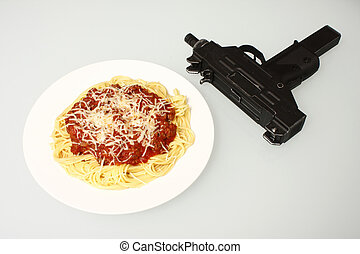Mafia dinner - A plate of spaghetti next to an automatic...