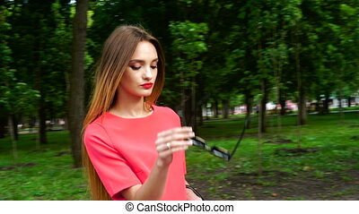 beautiful young business woman in red suit wears a black sunglasses