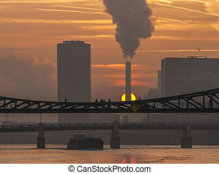 romantic sunset in Frankfurt at river Main with bridge