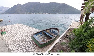 The boat is on the shore. Montenegrin fishing boats.