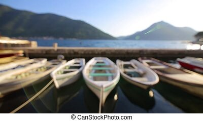 Wooden boats on the water. In the Bay of Kotor in...
