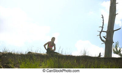 young blonde lady practicing at daytime outdoors
