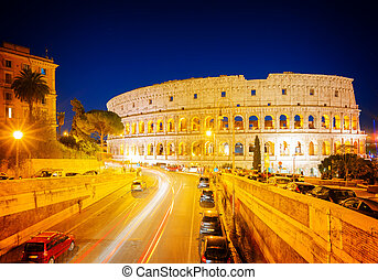 Colosseum in Rome, Italy - view of Colosseum illuminated at...